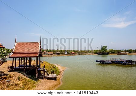 beautiful Thai house or thai pavilion with tree, river and blue sky background, selective focus