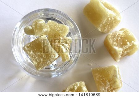 A glass full of dried golden ginger.