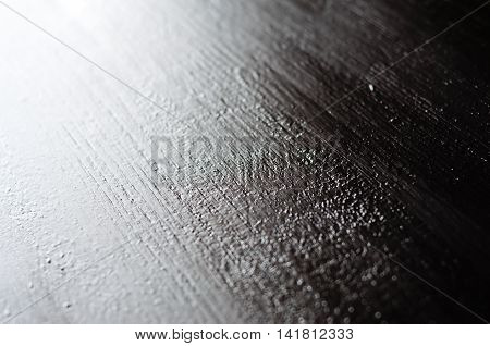Textured black wood board painted black near natural light. Backdrop template.