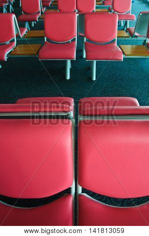 Row of empty chair at airport, pink chair