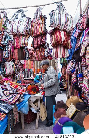Man Selling Peruvian Bags And Other Souvenirs