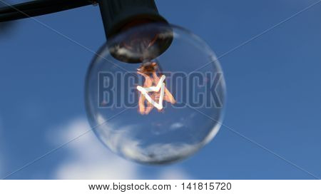 Glass Light Bulb Blue Sky White Clouds