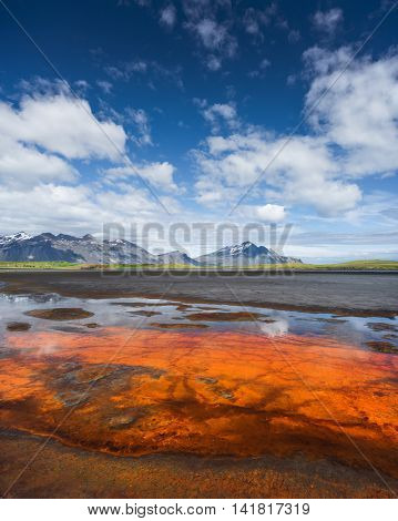 Summer landscape with  beautiful sky on a sunny day. Swamp at the bottom of the Bay. View of Cape Stokksnes, southeastern coast of Iceland, Europe
