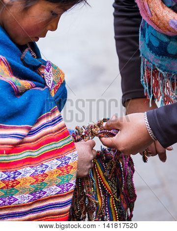 Young Girl Selling Crafts