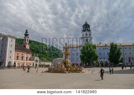 Beautiful View Of Residenzplatz With Famous Domquartier Salzburg And Dom Zu Salzburg On Background,