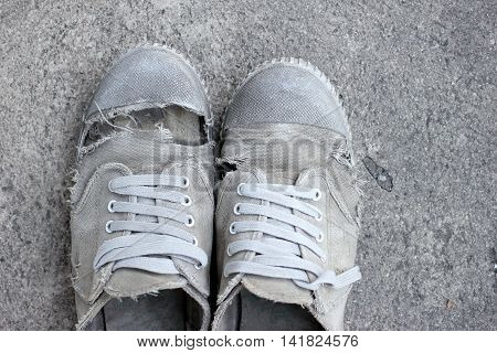 Dirty Old Shoes On Grass Background