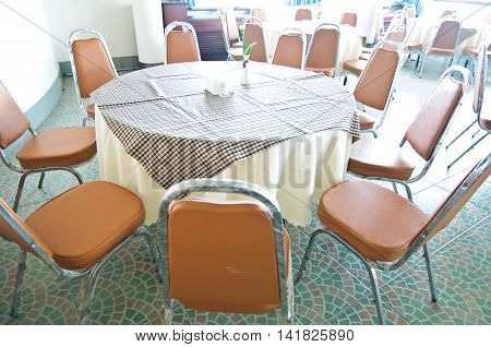 Hotel Hall interior with round tables set up for dinner