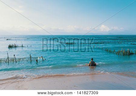 Dream Beach, Algae At Low Tide And Boy