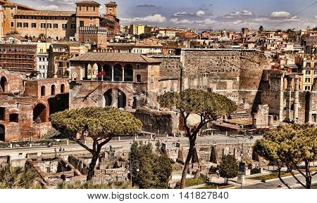 ROMA ITALY APRIL 11 2016 : View from the balcony of the national monument a Vittorio Emanuele II the museum complex on the Piazza Venezia to the ruins of Trajan's Market in Rome