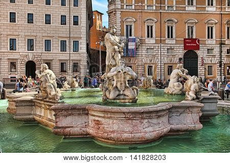ROMA ITALY APRIL 11 2016 : Piazza Navona Rome. Italy. Tourists admire the fountains on Piazza Navona