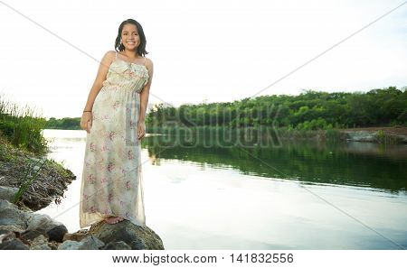 Girl In Dress Stand Next To Water