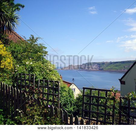 View of Runswick Bay through the Rooftops of the town