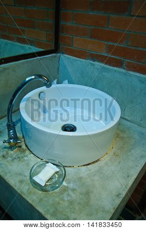 white washbasin in the bathroom, old washbasin