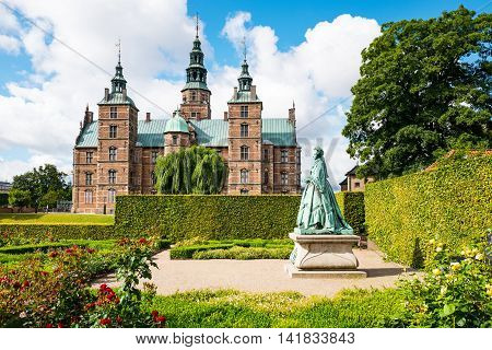 Copenhagen Denmark - July 20 2015: The Rosenborg castle seen from the King's garden with the statue of the Queen Caroline Amalie on the right