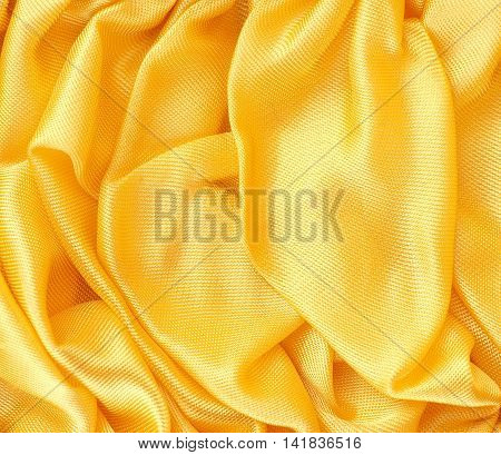 Golden satin fabric texture using as background with space for text or image