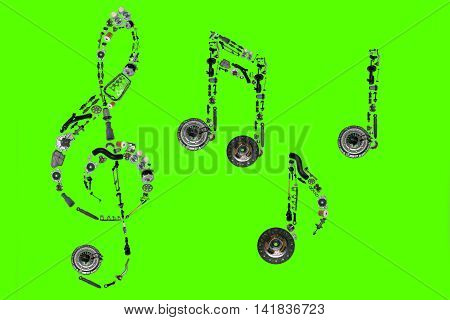 Treble clef assembled from new auto, spare parts. Spare parts for shop, aftermarket, OEM. Treble clef with spare parts. Auto parts for shop. Auto parts for car isolated on green screen, chroma key