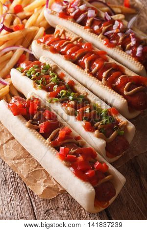 Hot Dogs With A Variety Of Stuffings Closeup, And French Fries On The Table. Vertical