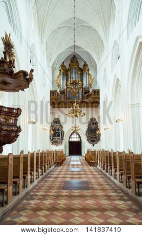 Odense Denmark - July 21 2015: The nave of the gothic St. Canute's Cathedral with the ancient organ