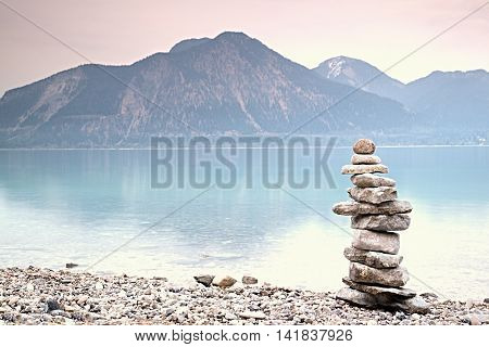 Balanced Stones On Mountain  Lakeshore. Children Built Pebbles Pyramid