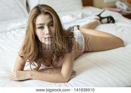 A Very Sexy Asian Girl Wearing Lingerie, Posing Very Sexy.