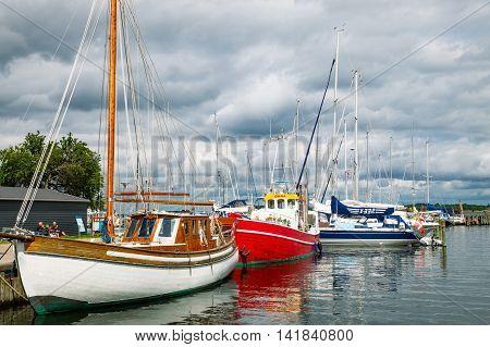 Roskilde Denmark - July 23 2015: Sailing boat moored outside the Viking Ship Museum