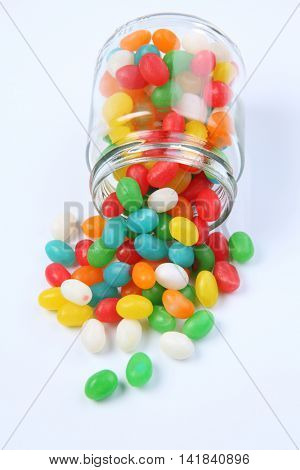 jelly beans pouring out from a jar