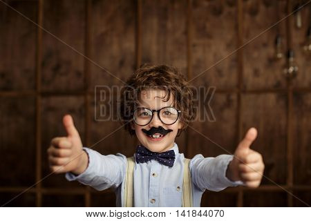 Smiling boy with a mustache