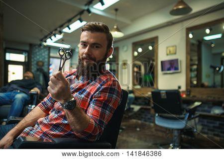 Smiling man in barber shop