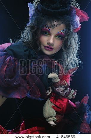 Fashion shot of woman in doll style.Creative make-up.Fantasy dress.