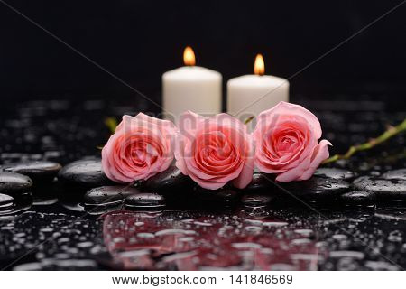 Beautiful rose with candle and therapy stones