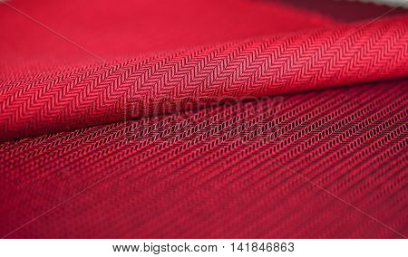 close up red fabric suit photo shoot by depth of field for object