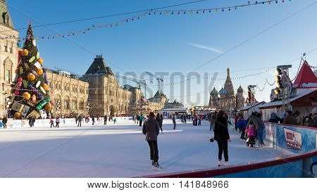 Moscow - November 29 2015: Big Christmas ice rink on Red Square and a lot of people are skating during the Christmas holidays and St. Basil's Cathedral November 29 2016 Moscow Russia
