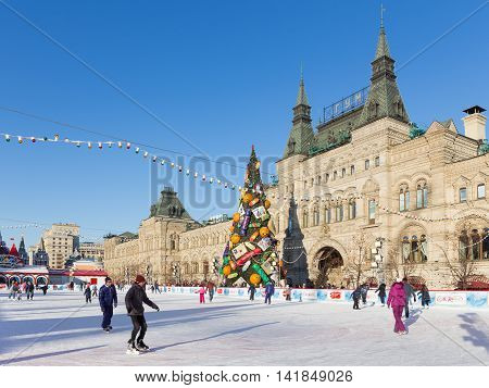 Moscow - November 29 2015: Big Christmas ice rink on Red Square and a lot of people are skating in the holidays and unusual Christmas tree November 29 2016 Moscow Russia