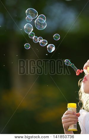 Air Bubbles blowing in the wind by kid