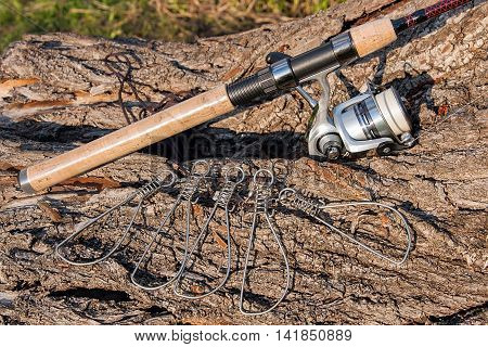 Fishing Rod And Reel On The Natural Background. Fish Stringer.