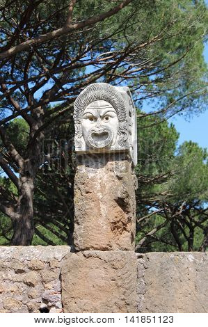 Satiric mask in Ostia Antica the old Harbour of Rome Italy