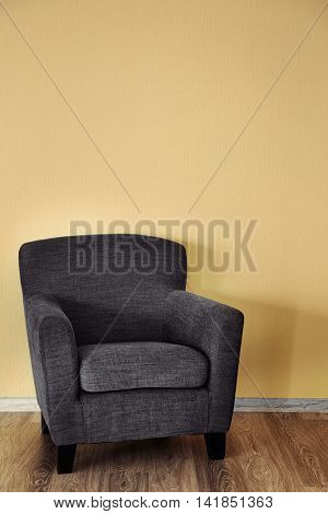 Modern chair on wall background