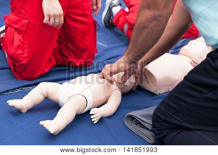 Cardiopulmonary resuscitation - CPR. Baby CPR dummy first aid training.