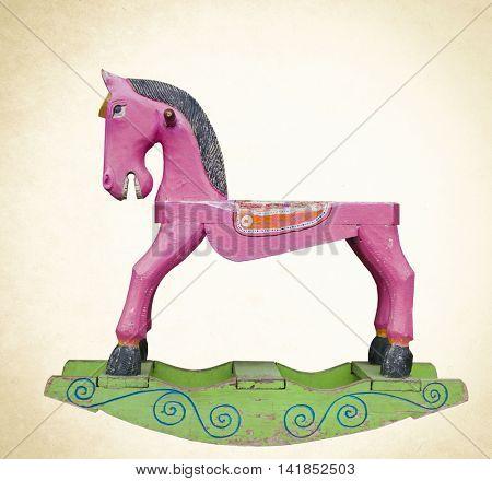 old Pink wooden rocking horse