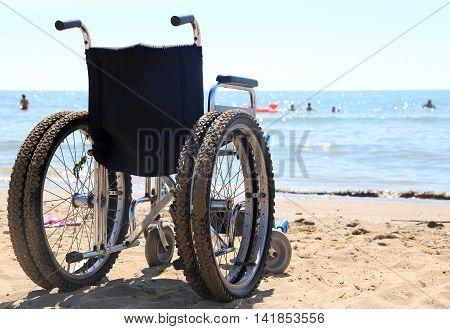 Wheelchair Aluminum On The Sand Of The Beach