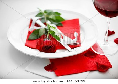 Romantic table setting with wine closeup