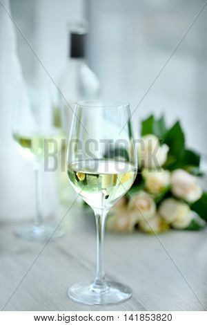 Gentle composition of romantic date with wine and flowers