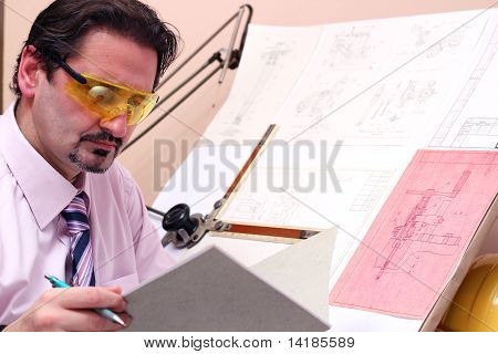 Portrait Of Handsome Engineer In Office