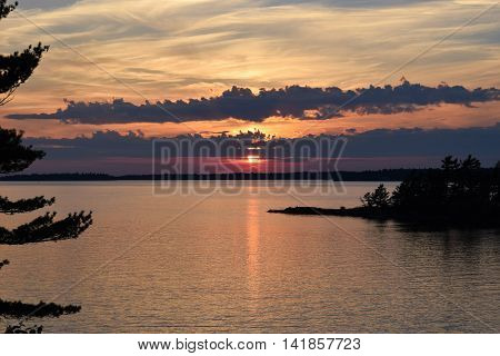Photograph of a sunset over an island