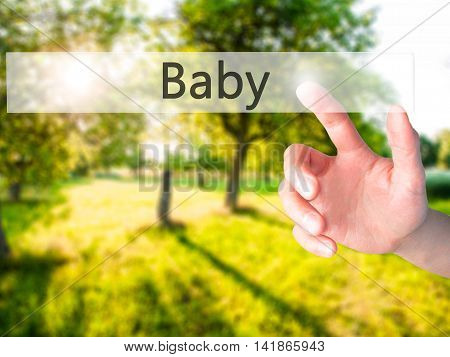 Baby - Hand Pressing A Button On Blurred Background Concept On Visual Screen.