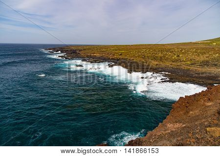 Wild barren coast of Tenerife and powerful waves of Atlantic ocean Canary islands Spain