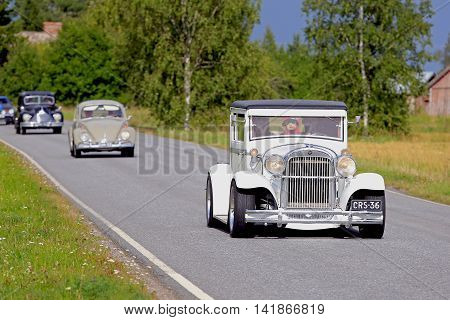 SOMERO, FINLAND - AUGUST 6, 2016: White Essex Super Six year 1929 classic car participates the 90 km Maisemaruise 2016 drive along scenic roads of Tawastia Proper Finland. Public event.