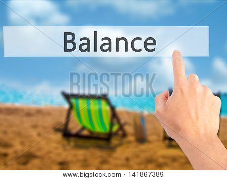Balance - Hand Pressing A Button On Blurred Background Concept On Visual Screen.