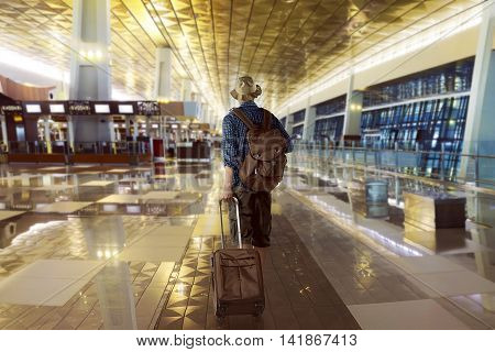 Traveler Carry His Bag In The Airport