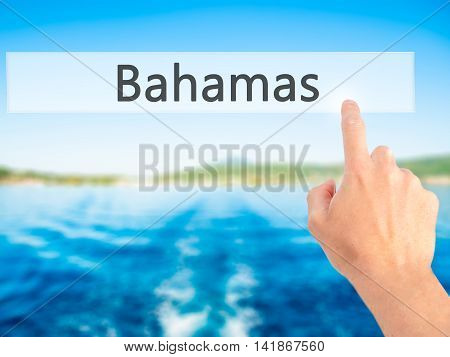 Bahamas - Hand Pressing A Button On Blurred Background Concept On Visual Screen.